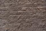 Gray brick wall.