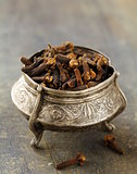 Dried spice cloves on a wooden table