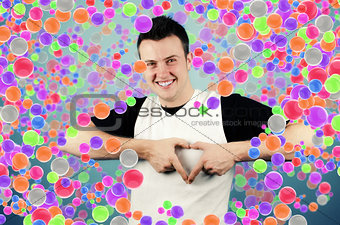 Young man making heart sign with palms