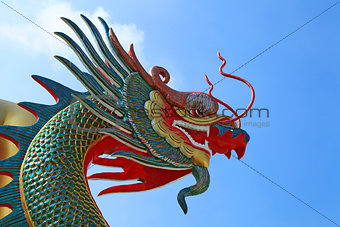 Head of Dragon on the blue sky