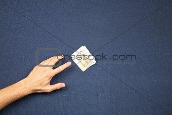 hand take wad of euros