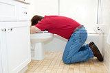 Man Throwing Up in Bathroom