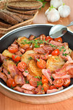 Fried potatoes with meat and vegetables