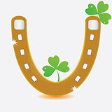 Horseshoe and four leaf clover.