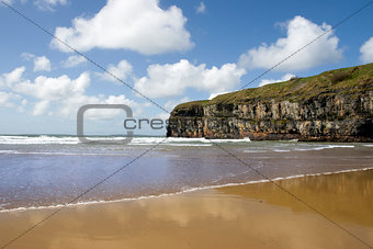 Atlantic waves on Ballybunion beach and cliffs