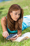 Woman Outside Eating Blueberries &amp; Reading Book