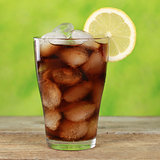 Cola in a glass with ice cubes