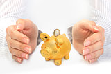 Piggybank and hands.