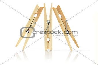 Three Wooden Clothes Pegs