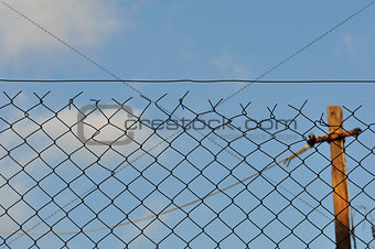 chain link fence and blue sky