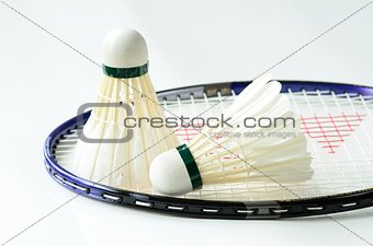 Badminton racket and shuttlecocks concept of sport