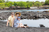family at the black sand beach