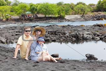 family at the black sand beach