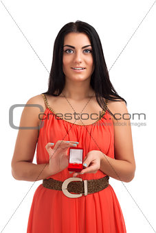 Young woman with engagement ring in box