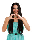 Young woman forming heart shape with hands