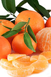 tangerines with leaves and silces