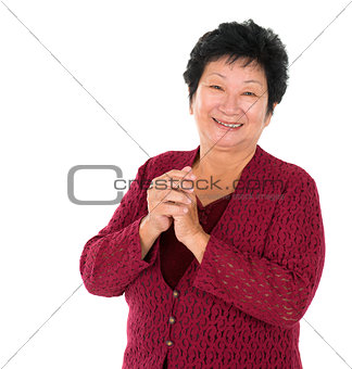 Chinese senior woman greeting