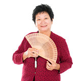 Oriental senior woman with Chinese Fan