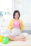 Asian pregnant woman exercising