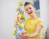 Happy young woman with Easter decoration