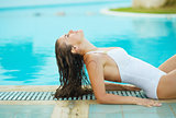 Young woman relaxing in poolside