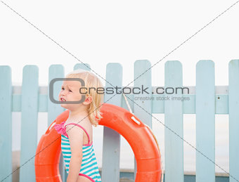 Portrait of baby with lifebuoy