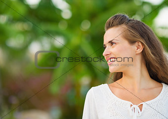 Happy young woman looking on copy space