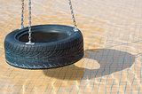 Tyre swing in a swimming pool
