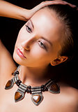 Adorable Woman with Metallic Necklace and Amber. Natural Makeup
