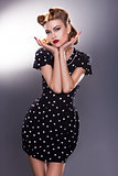 Stylized Retro Woman in Blue Polka Dot Dress - Vintage Style