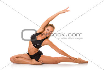 Smiling woman doing stretching exercise