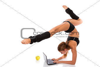 Flexible gymnast with laptop and apple