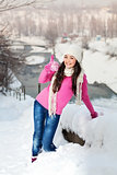 Smiling girl on snow winter background