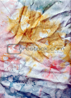 A close-up of a silk fabric colored by batik