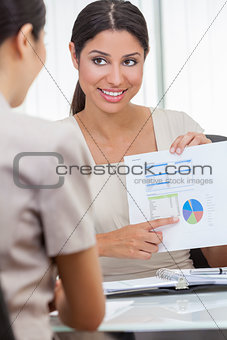 Woman or Businesswoman in Meeting with Graph