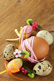 Easter decor eggs on wooden background