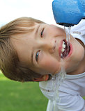thirsty young boy closeup