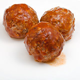 three meatballs under meat sauce