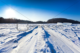 ski track at snow field in cold winter day