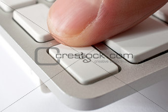 Finger pressing ESC key