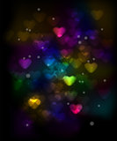Colorful Hearts Bokeh on a Dark Background
