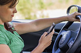 Woman driver reading a text message
