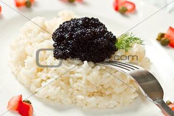rice with black caviar