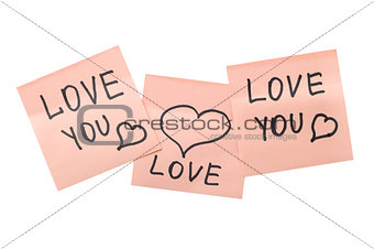 three pink sticky notes with hearts