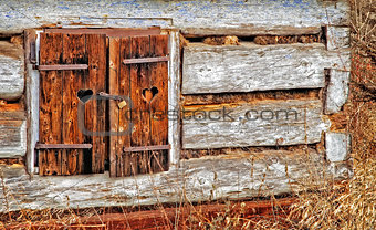 Old window with closed woody shutter
