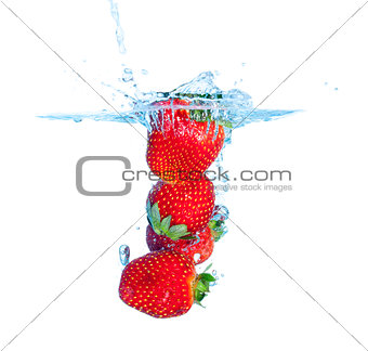 Fresh Strawberry Dropped into Water with Splash