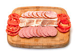 Assorted Slice Sausage, Bacon and Tomato on Cutting Board