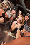 Female Nerd Arm Wrestling with Biker