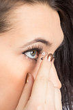 Young woman with contact lense