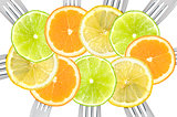 citrus fruit sliced on forks